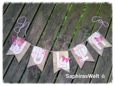 Baby Julia bekommt eine Wimpelkette – Alphabet Punch Board