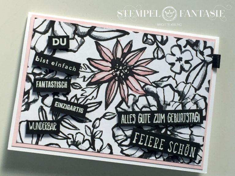 Schwarz-weiße Geburtstagskarte mit kolorierten Blüten